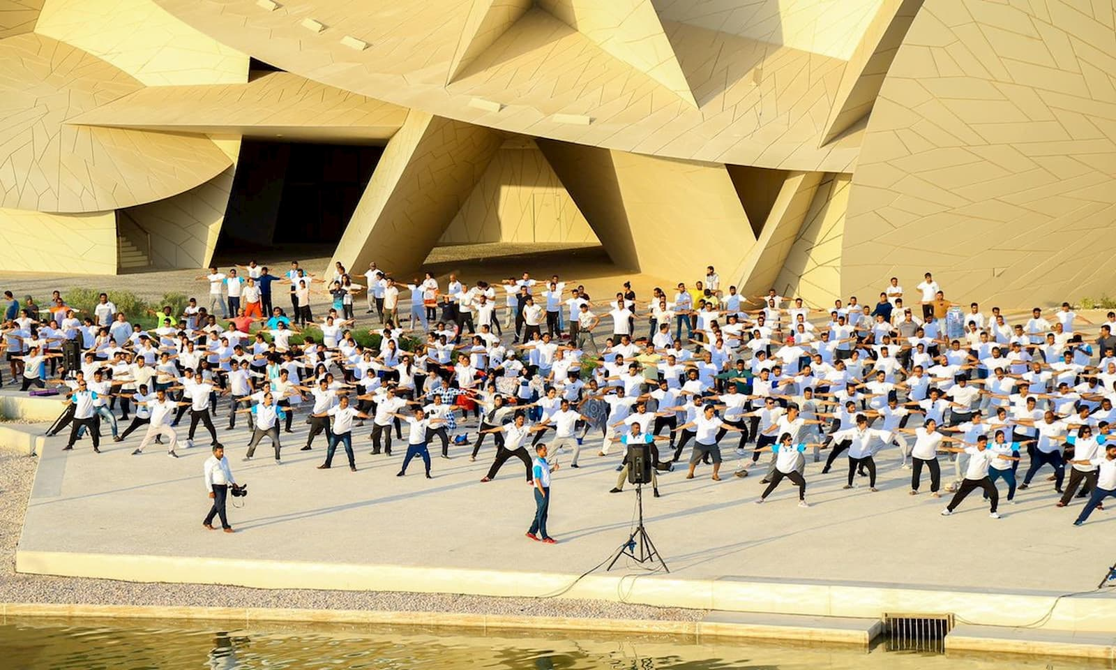 This is an image of Indians in Qatar celebrating International Day of Yoga 2019