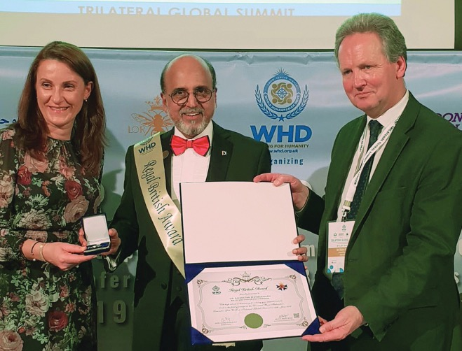 This is an image of Doha Bank CEO R Seetharaman receiving the award