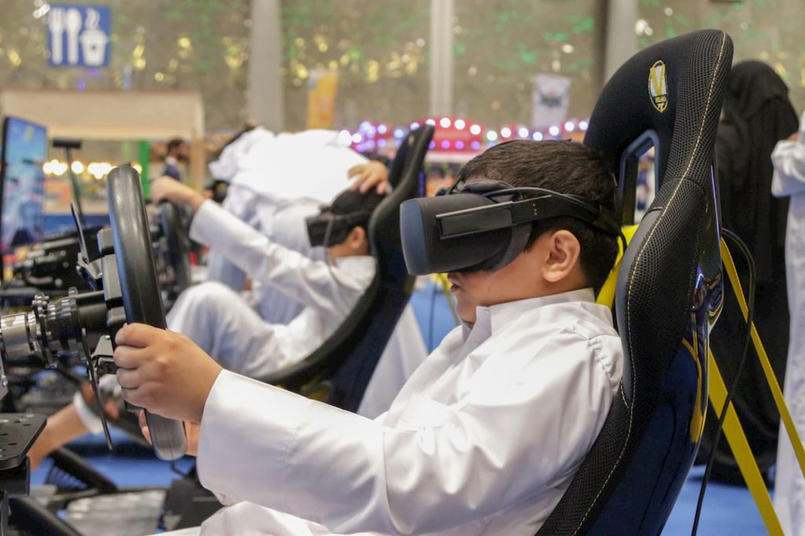 This is an image of a kids enjoying VR games at SEC.