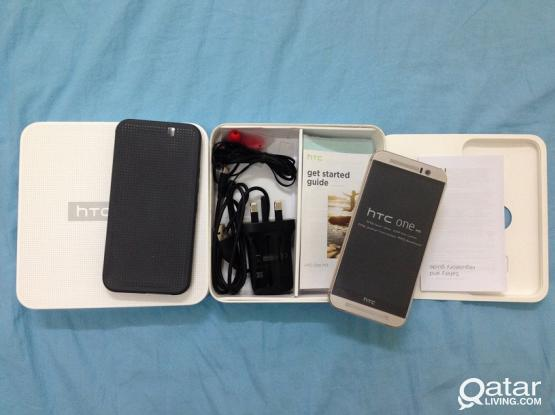 NEW HTC ONE M9 WITH ORIG DOT VIEW 2 CASE FOR SALE ONLY 2000 QAR
