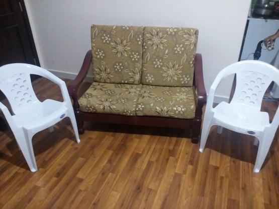 Two seater wooden sofa with mattresses Two chairs
