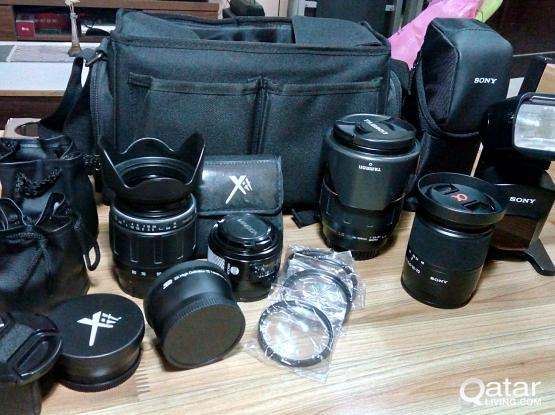 Sony a77 SLR + 5 lenses, battery grip, speed light and more