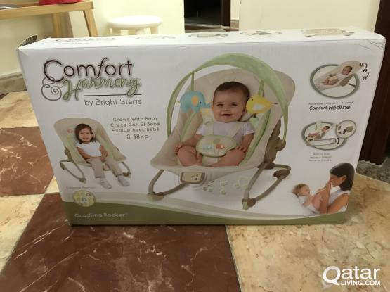 Baby cradling rocker with music and vibration