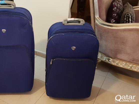 A pair of Luggage/ suitcases