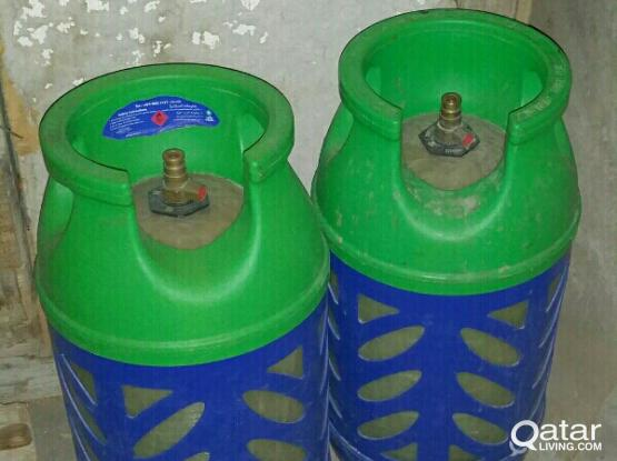 two woqood gas bottles