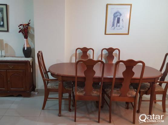 Dining table with chairs and side cabinet