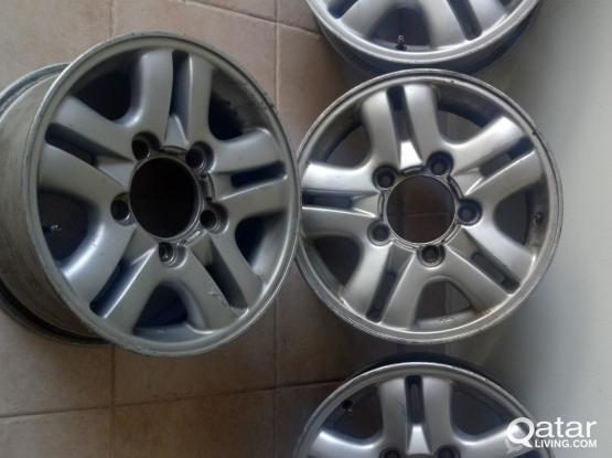 4 Lexus rims size 16 with covers and bolts