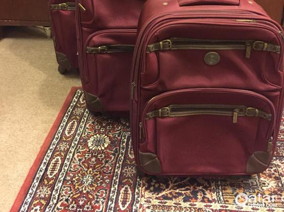 Suit cases and room carpets
