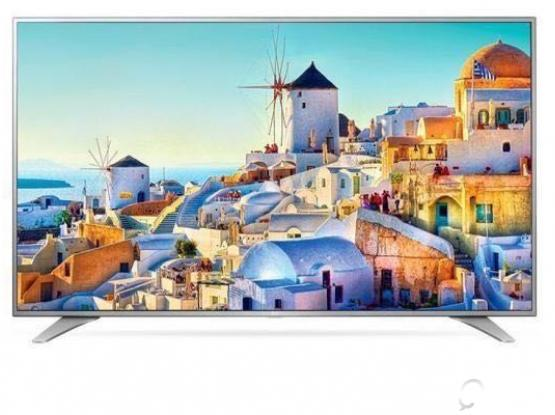 LG UHD Smart TV and JBL Audio System and TV stand