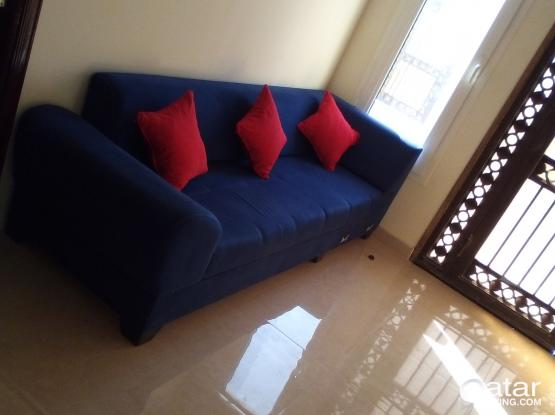 Sofa and glass coffee table for sale