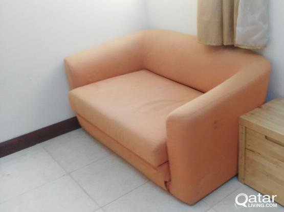 Sofa-Bed and Tea Table for sale.