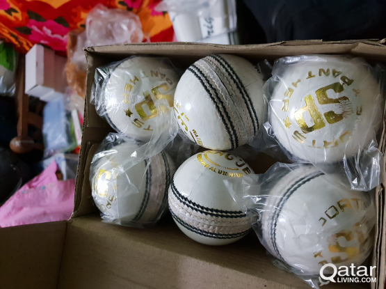White and Red Cricket Balls