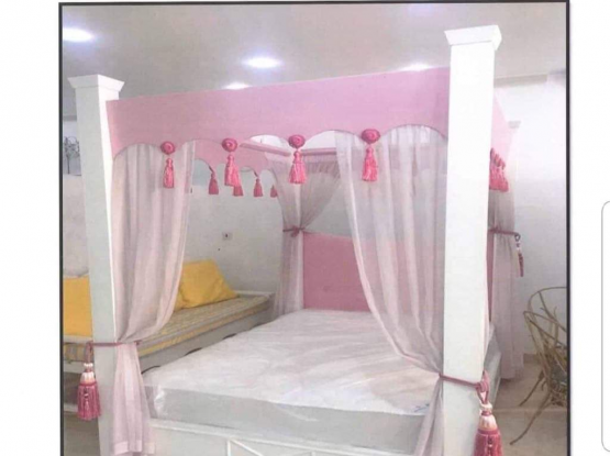 Bed with pink frame