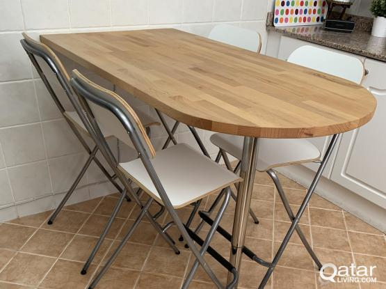 Wooden table and 4 chairs.