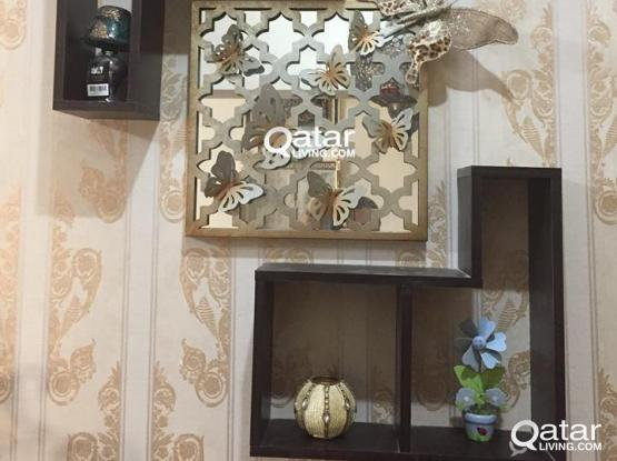 Beautiful Decorative artwork with accessories and tableau