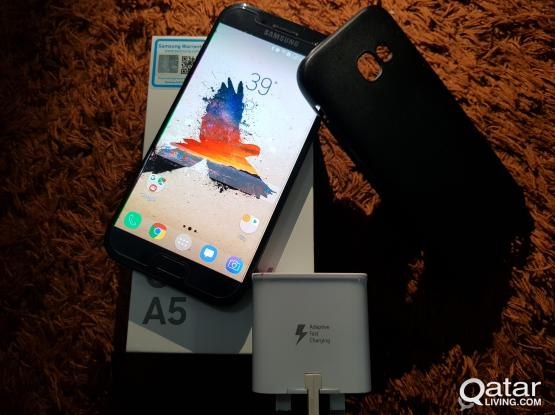 Samsung Galaxy A520 with accessories