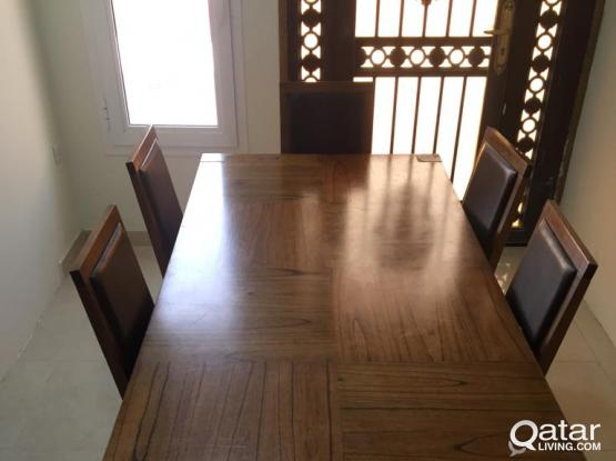 Wooden dinning table with leather chairs for sale