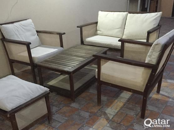 Outdoor sofa includes foot rest