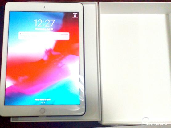Brand new iPad 6th generation 32 GB model + free magnetic cover