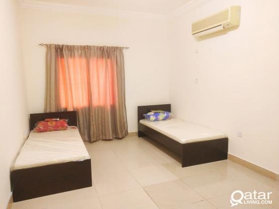 Fully Furnished Sharing / Single Room executive bachelor with home gym facility at salwa road near Sports Corner Signal