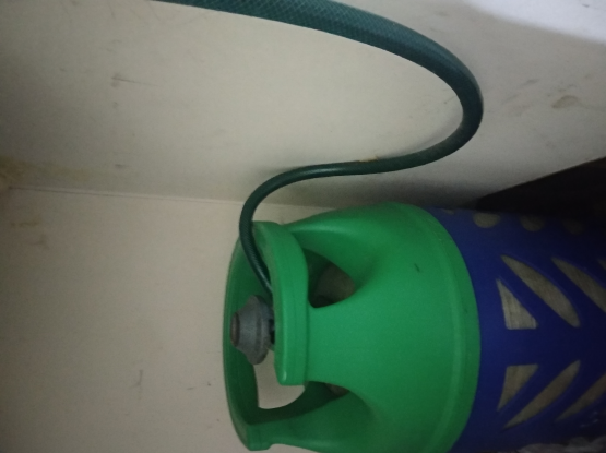 gas cylinder with regulator and pipe