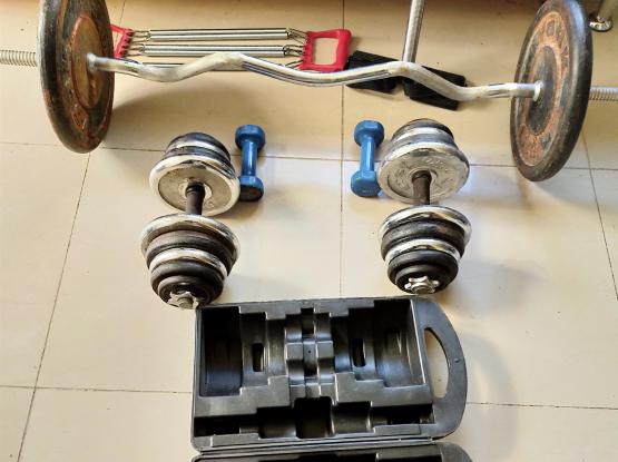 Weight lifting items dumbbells/Barbells  assorted