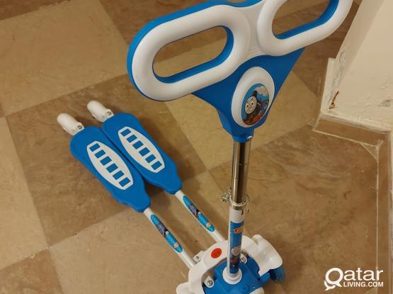 Scooty 4 wheels adjustable height