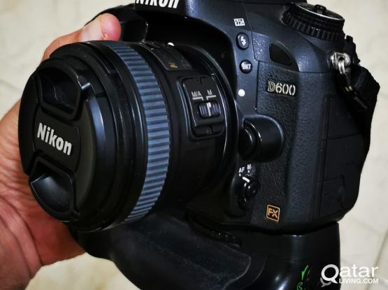 Nikon d600 full frame camera with 50mm f1.8 and battery grip