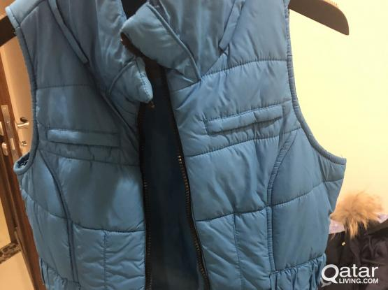 Blue long winter coat and light blue jacket with hood and belt
