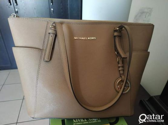 Micheal Kores and Clark's Handbags