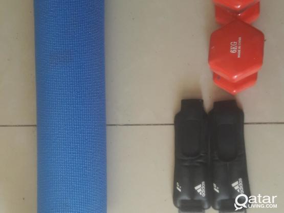 Yoga mat with dumbells, ab roller and ankle weights set for sale