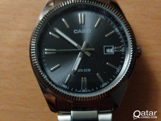 CASIO SILVER WATCH WITH BLACK DIAL