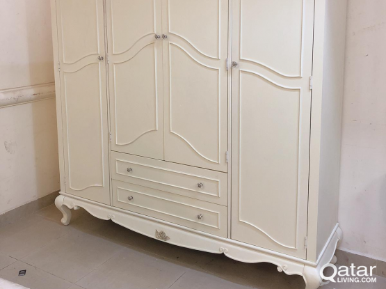 For sell off white colour 4 door cupboard
