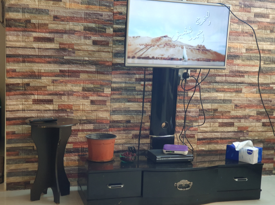 Tv and table and humax receiver