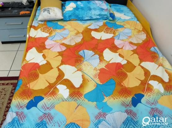 Kid's Bed with mattress and side table.