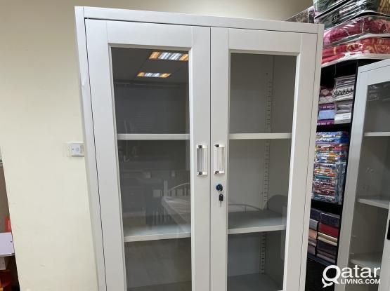 FILE CABINET HALF GLASS PH- +97477850533