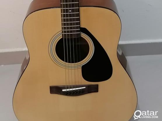 Yamaha acoustic guitar - F 310 with stand (negotiable)