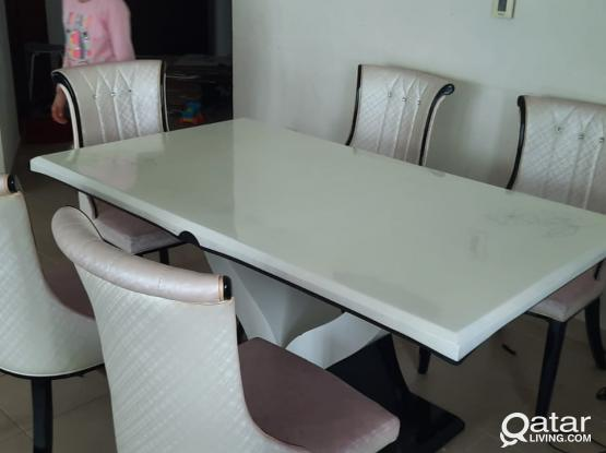 Dining table of white stone top