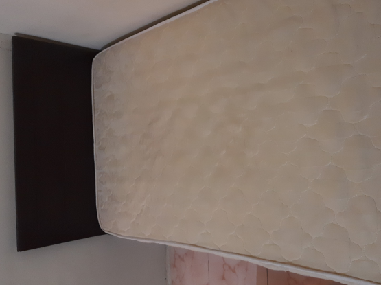 Single bed with a mattress