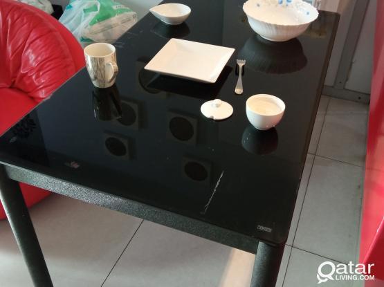 kitchen table.  iron legs, durable glass top.  Size: 120cm long, 70cm wide.
