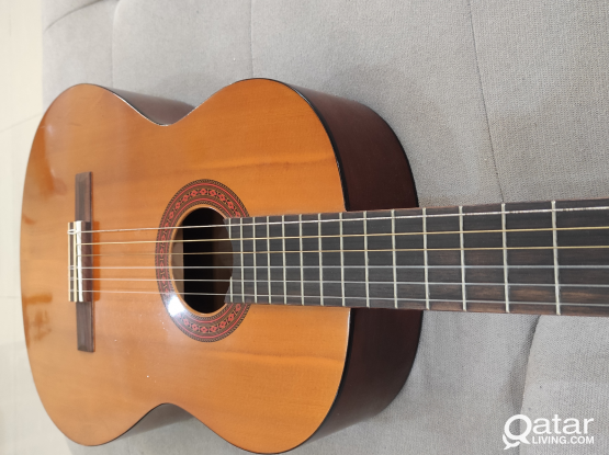 Yamaha acoustic guitar with 6 set of strings
