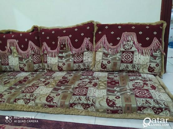 Majlis with 4 pillows.