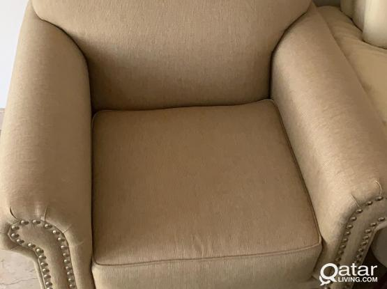 Singe seater sofa and 65inch tv