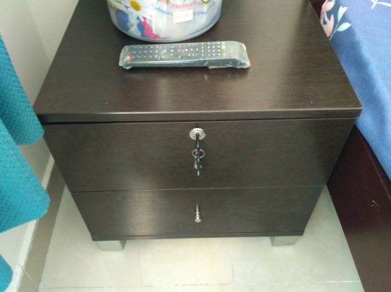 Small side table black color with two drower.