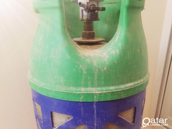12 litre gas cylinder full with gas with all the attachments.