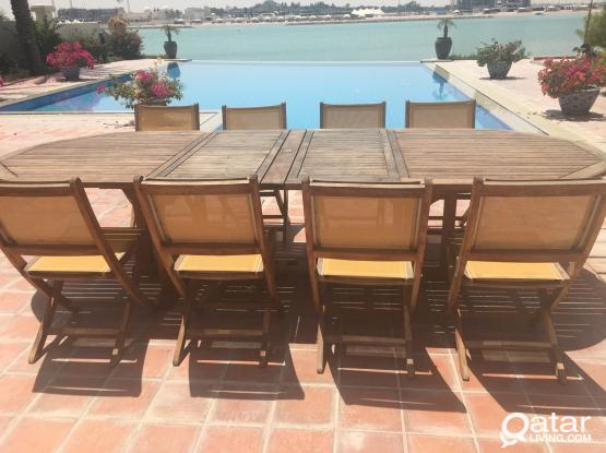 Outside wooden table with 8 chairs