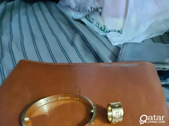 Cartier bracelet + small round can be used as pendant,d&g earrings
