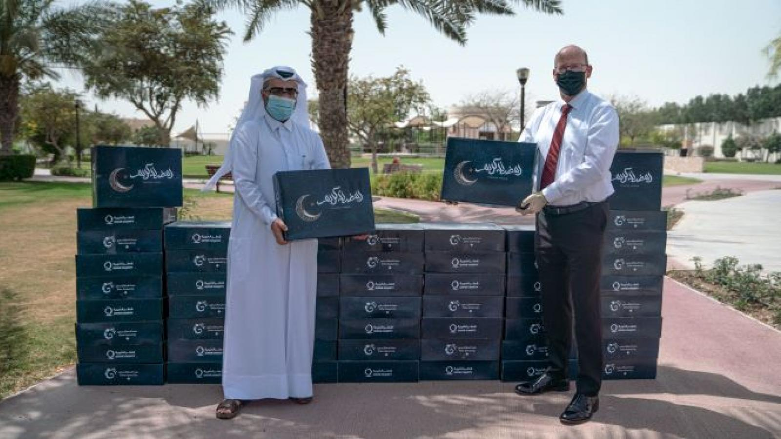 DFC partners with QC to donate 1000 boxes of essential Ramadan food supplies