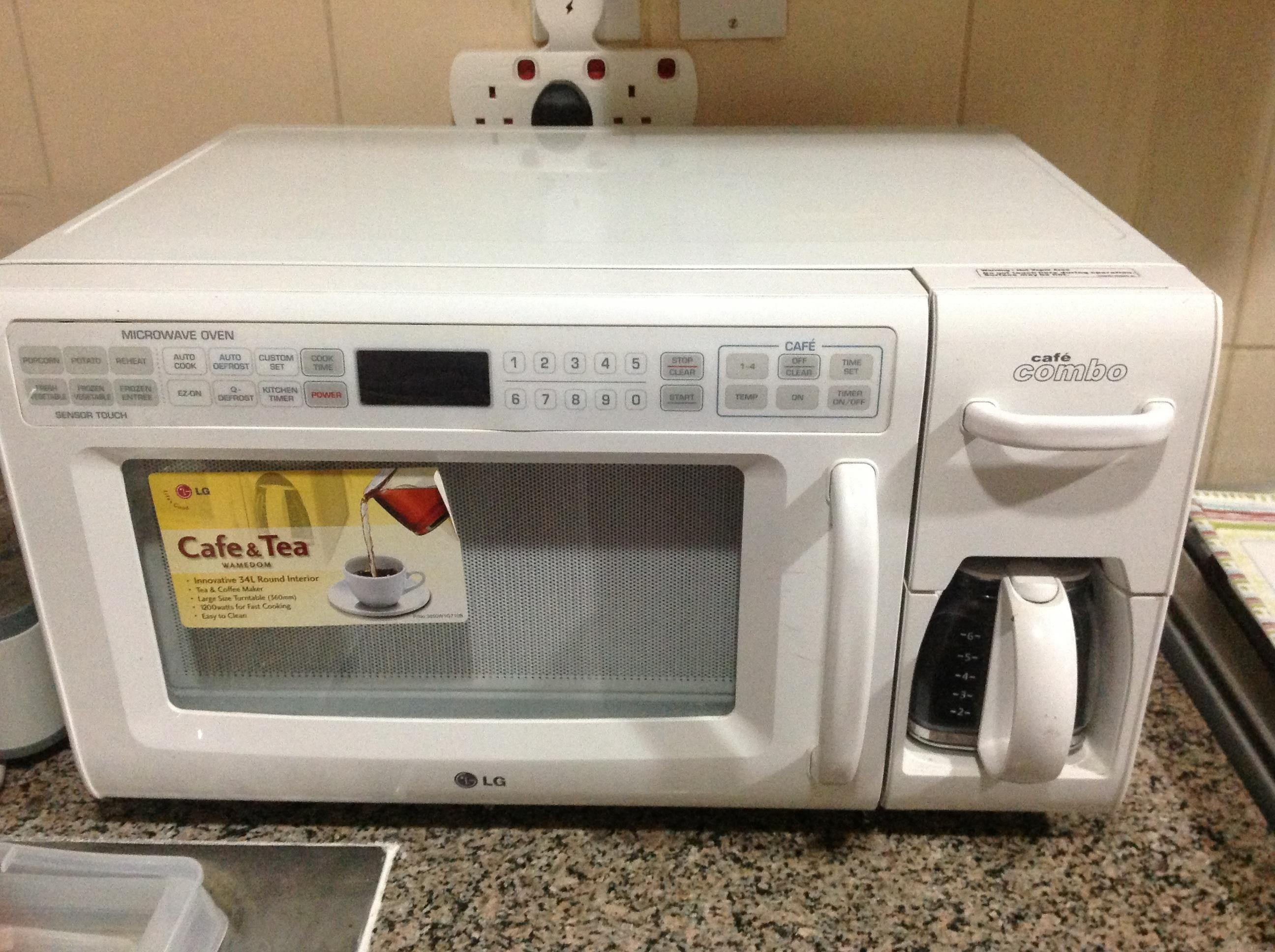 Le Information A Barely Used Lg Microwave Oven And Coffee Maker Combo