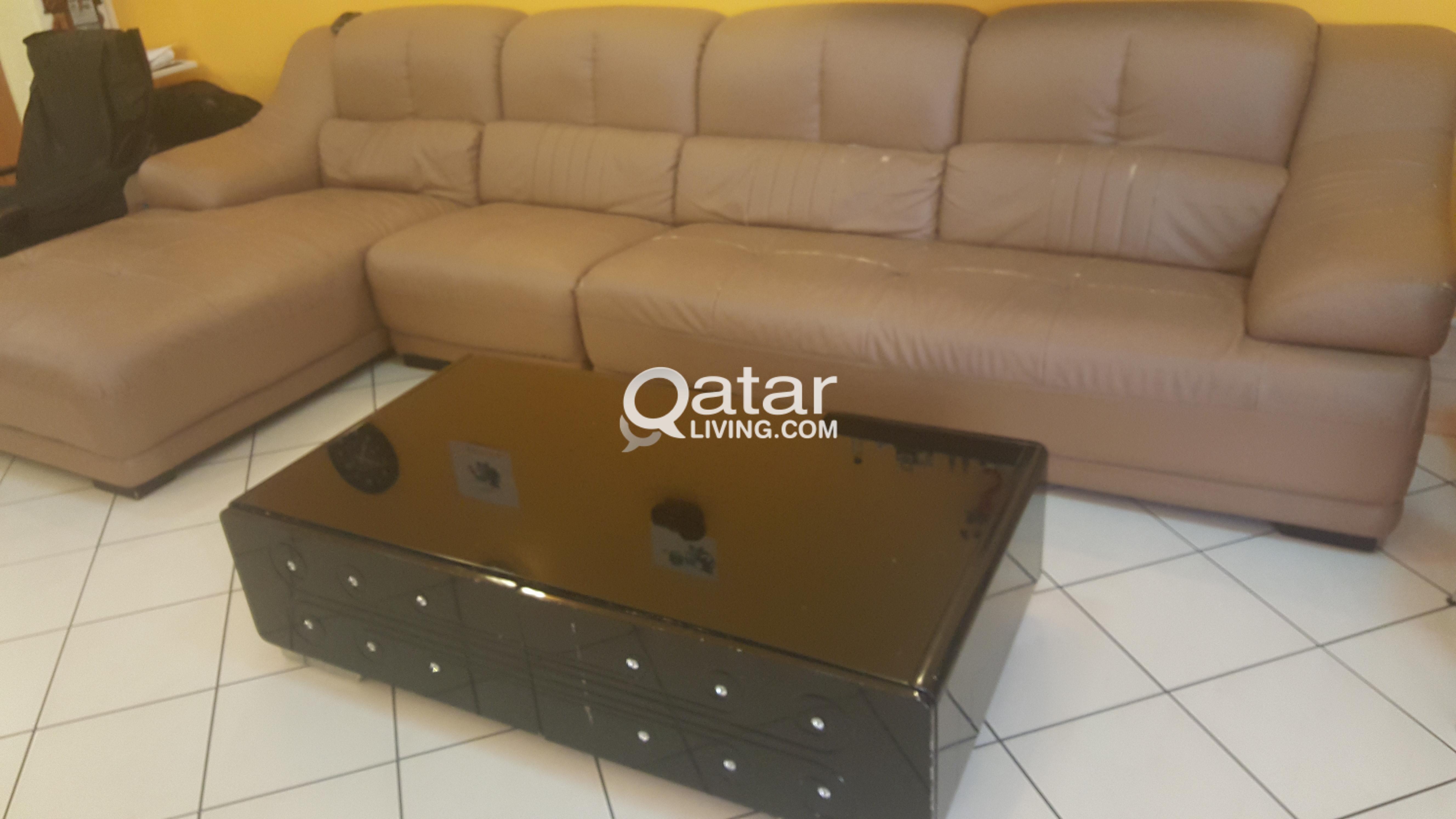 clearance sale-corner sofa bed(4+1)+center table | qatar living